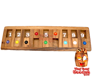 Shut the box or flap game as a game board version for the journey. Funny drinking dice game for the round Monkey Pod Thailand