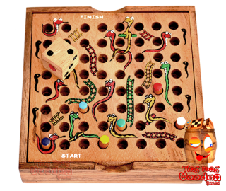 Snake ladder children dice game, kids play in a wooden box monkey pod wooden games Thailand